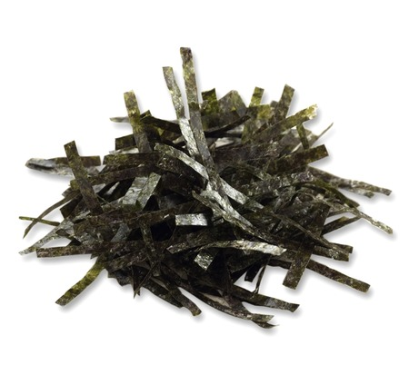 stripe of dried seaweed on white background