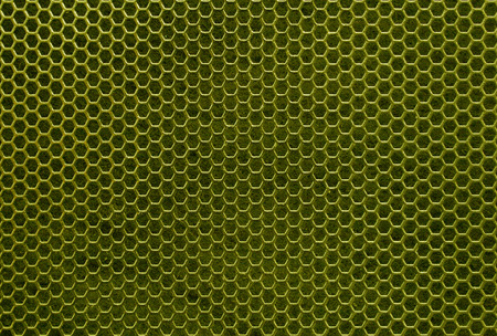yellow iron hexagonal texture. Industrial background  photo