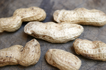monkey nuts: Peanuts on old wooden Stock Photo