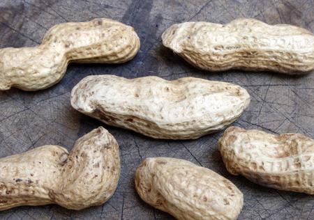 monkey nut: Peanuts on old wooden Stock Photo