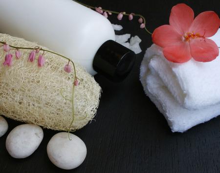 Natural Luffa Sponge , bottle cream  and white towel  photo