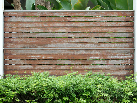 Old wooden brown fence wall texture as background photo