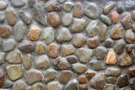 background made of a closeup of a wall with pebbles Stok Fotoğraf