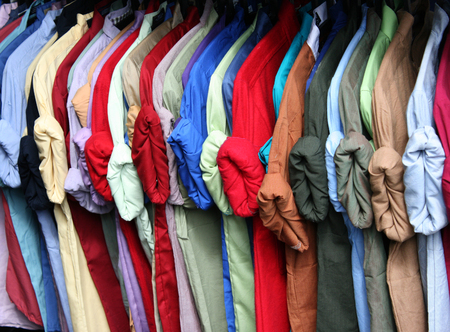 colorful shirt rack on hanger in a row photo