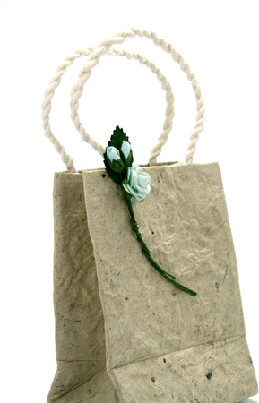 Brown mulberry paper bag isolated with flower photo