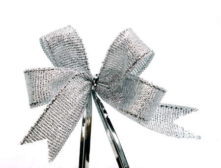 silver ribbon with bow on white Stock Photo