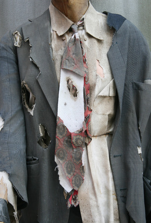 wearing a ripped and hole