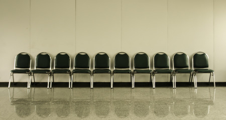 chairs in ordinary empty waiting room Stock Photo
