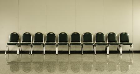 chairs in ordinary empty waiting room Standard-Bild