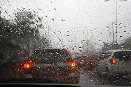 storms: Road view through car window with rain drops, Driving in rain.