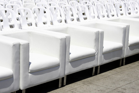 outdoor event: Empty with white armchairs and plastic chair outdoor event Stock Photo