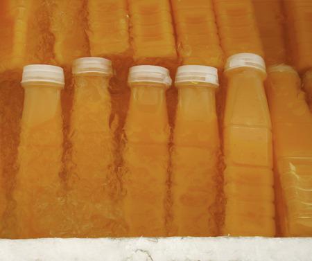 Ice Cold Orange Juice Bottle photo