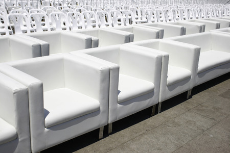 line lines luxury meeting: Empty with white armchairs and plastic chair outdoor event Stock Photo