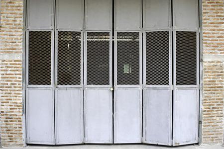 fanlight: old steel sheets door with iron net