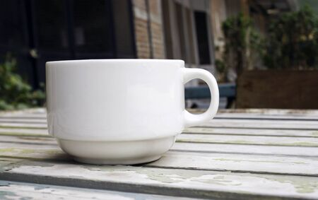 decaffeinated: Coffee cup on wood table with blur background Stock Photo
