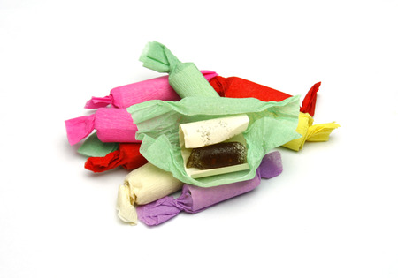 taffy: multicolored taffy candy on a white