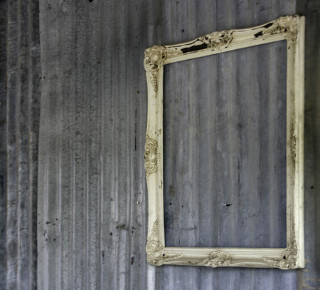 blank frame on metal wall background photo