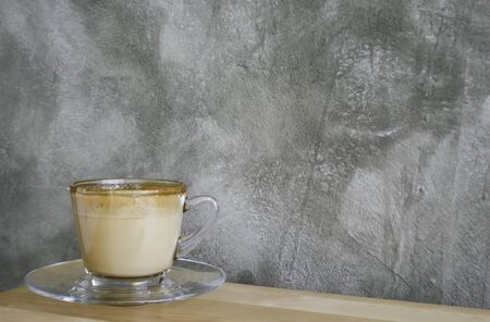 gaffe: latte coffee on a wood table Stock Photo