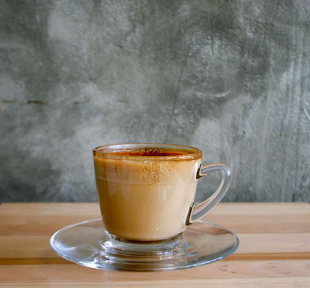 cappaccino: latte coffee on a wood table Stock Photo