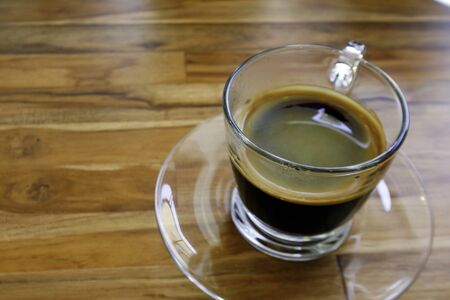 gaffe: black coffee on a wood table Stock Photo