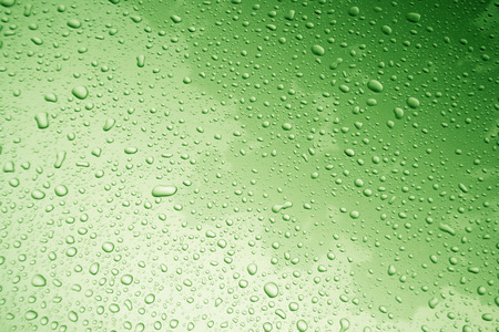 water drop on body of car for background with green filter