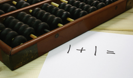 economic revival: abacus on wood table Stock Photo
