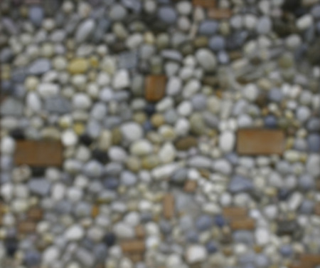 blurred blackground : background made of a wall with pebbles