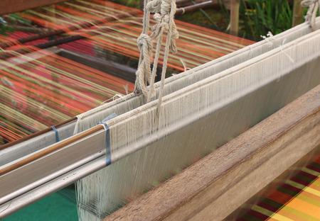 Old weaving loom and shuttle