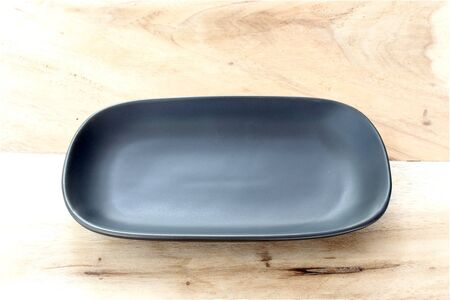 dish disk: black plate on the table Stock Photo
