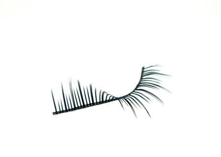 fake eyelashes: false eyelashes isolated on white Stock Photo