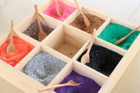 tantra: Colourful sands in wood box Stock Photo