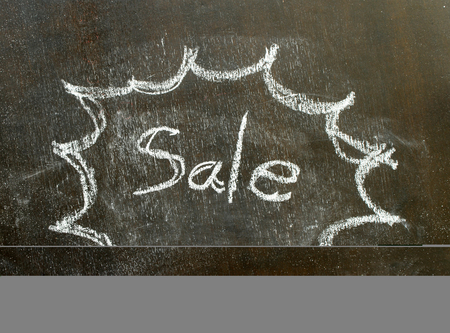 utterance: the word sale in bubble sign