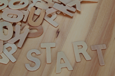 Word start made with wooden letters alphabet