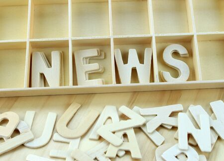 remark: Word news made with wooden letters alphabet