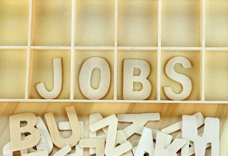 remark: Word jobs made with wooden letters alphabet Stock Photo