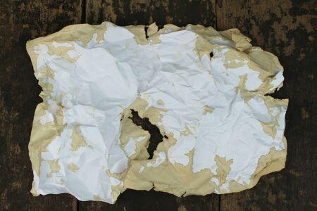 desperado: old paper on brown aged wood