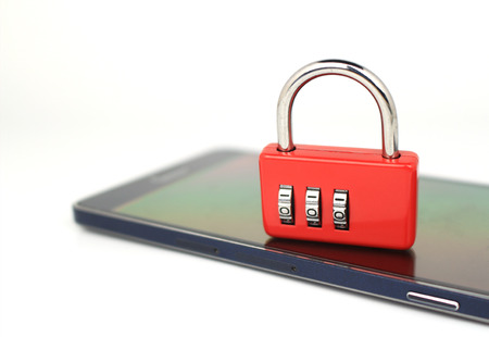 Padlock on a smartphone, security concept