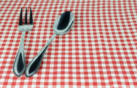 food absorption: Silverware fork and spoon on tablecloth for food serving background