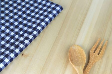 food absorption: fork and spoon and tablecloth for food serving background