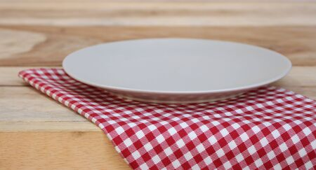 food absorption: the plate on checkered tablecloth