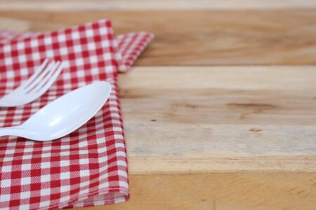 food absorption: fork and spoon on  tablecloth for food serving background