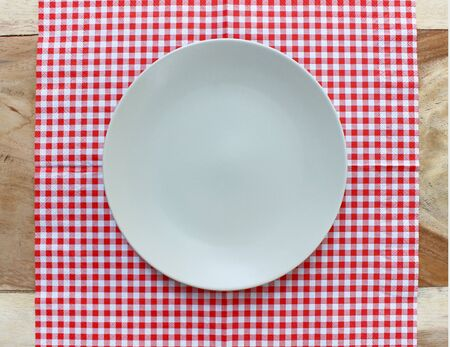 checkered tablecloth: the plate on checkered tablecloth