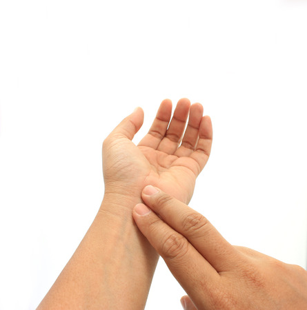throb: human hand checking himself the pulse