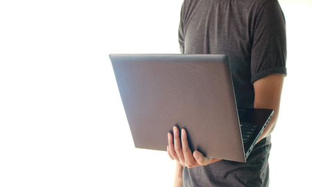 lap top: Man holding the lap top Stock Photo