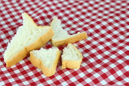 crumb: crumb of bread on tablecloth Stock Photo