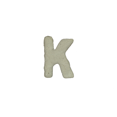 consonant: The K letter cement texture with clipping path