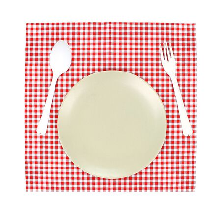 food absorption: Top view plate and  spoon, fork on red tablecloth texture