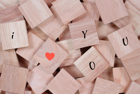 wooden block: wood background : message I love you spelled in wooden block