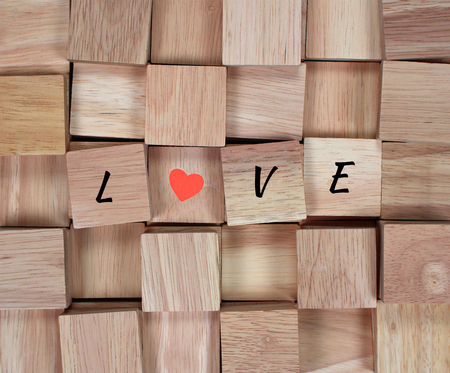 wooden block: wood background : message love spelled in wooden block Stock Photo