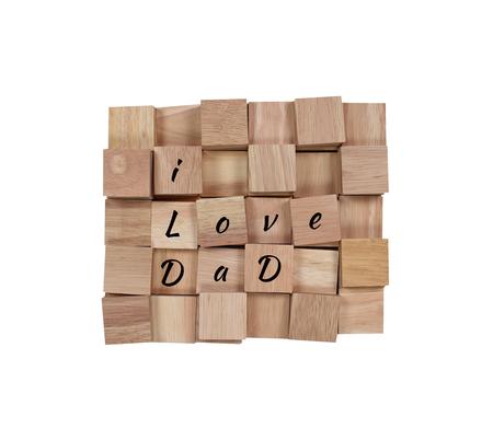 wooden block: wood background : message I love dad spelled in wooden block